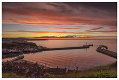 Whitby Harbour Sunset (John Joslin) Tags: a7r beautiful colour color dusk england evening environment whitby yorkshire north sunset harbour sony zeiss loxia2821 landscape light loxia sky clouds sea water ocean pier town houses
