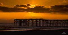 Sunset at Imperial Beach Pier: August 2010 (ESKPhotography) Tags: san diego pier sunset sea clouds beach summer surf silhouette fishing usa california west coast sand sun golden sky nikon d50