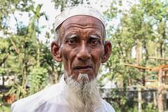 Rohingya Old Man (Galib Emon) Tags: rohingyaoldman portrait rohingya people rohingyarefugee rohingyarefugeeinbangladesh rohingyarefugeecrisis rohingyamuslims aidforrohingya crimesagainsthumanity rakhinestate myanmar photojournalism humanrights galibemon street aidsearching un burma muslim violations humanity militarycrackdown arakanrohingya salvationarmy help genocide rohingyarelief rohingyaissue refugees rohingyapeople rohingyaportrait homeless refugeecamp explore unchiprang ukhiya teknaf coxsbazar chittagong bangladesh global world travel hopeless unhcr 1millionrohingyarefugeesinbangladesh september 2017 stoptheviolenceagainsttherohingyainmyanmar influx unchiprangmakeshiftcamp streetphotography dof eyes face crossedtheborderintobangladesh naturallight unchiprangrohingyarefugeescamps curious explorebangladesh exploreworld unicef oldman