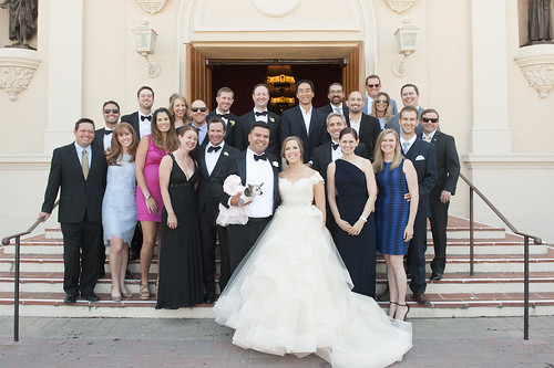 Newlyweds Francisco Zepponi and Amanda Bloomberg on the steps of the Mission Church with fellow alumni