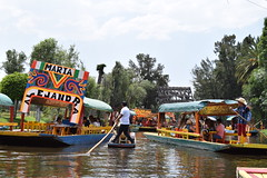 Elote sellers gliding through the busy waterways of Xochimilco (nickdippie) Tags: mexico xochimilco ciudaddemexico canal boat canalboat gondolier colourful elote streetfood canalfood