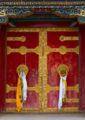 Ornate knockers on traditional buddhist door temple in Hezuo monastery, Gansu province, Hezuo, China (Eric Lafforgue) Tags: amdo anduozangdistrict antique architecturaldetail architecture art asia buddhism china china17393 chinese colorful colourimage cultural cultures decoration door doorknob doorway entrance entryway gannantibetanautonomousprefecture gansuprovince heritage hezuo knocker locked monastery nopeople old ornate portal prayerflag red religion scarf temple tibet tibetan touristdestination vertical worldtravel chn