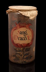 A61759|10687413 (gorbutovich) Tags: glassdrugjardragonsbloodsangdracovbloodchemist glass drug jar dragons blood sang dracov chemist pharmacy medical glassware medicine 1600s 1700s 18th century 17th decorative wizard wizardry witch herb herbal remedy sarah j duncan cylindrical draco dragon labelled parchment probably spanish