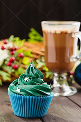 Blue cupcake with stars sprinkle (Aleksa Torri) Tags: christmas food cupcake background sweet cake festive dessert xmas icing cream decoration holiday sprinkles buttercream candy green baking celebrate christmastree concept confectionery cup event gift greeting homemade muffin newyear ornate party pastry recipe seasonal swirl tradition whipped winter holly noel red stars glitter shape wreath blue wooden cocoa coffee glass