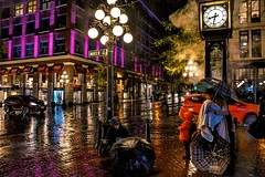 Under umbrellas (Christie : Colour & Light Collection) Tags: gastown vancouver bc canada historicalsite history historic umbrella rain britishcolumbia downtown candid people rainy 1800s warehouse storefront reflections cobblestone steamclock lamppost lights waterstreet steam clock darknight wetnight nightphotography christiecolourandlightcollection nightseries thecolourpurple thecolorpurple purple traffic outdoors plaid umbrellas streetphotography street streetphoto water colours colors time windows