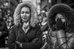 In The Hood (Leanne Boulton) Tags: portrait people urban street candid portraiture streetphotography candidstreetphotography candidportrait streetportrait eyecontact candideyecontact streetlife woman women female girl girls face faces facial expression eyes look emotion feeling mood hand gesture hood fur furry winter cold weather christmas parade tone texture detail depthoffield bokeh naturallight outdoor light shade shadow city scene human life living humanity society culture canon canon5d 5dmkiii 50mm primelens ef50mmf14usm black white blackwhite bw mono blackandwhite monochrome glasgow scotland uk
