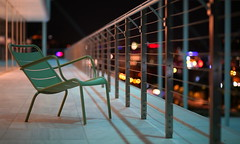 Looking for some company... (Michael Kalognomos) Tags: chair bokeh ef85mmf18usm canoneos5dmarkiii dof depthoffield armchair alone lonely color colorful nightlights snfccstavrosniarchosfoundationculturalcentre night greece streetphotography streetlife