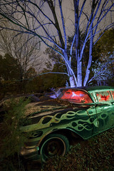 Cadillac Flames (Notley Hawkins) Tags: httpwwwnotleyhawkinscom notleyhawkinsphotography notley notleyhawkins 10thavenue lightpainting car auto boneyard abandoned trees fall outdoors sky 2017 november night nocturne evening salvage salvageyard junkyard cadillac flames tree rgb red green blue light