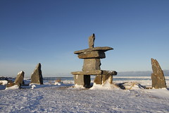 Set of rocks and a inuksuk and inukshuk found in early November near Churchill, Manitoba (Blue Tale) Tags: noperson sky outddors rock travel stone landscape winter sculpture art ancient monument daylight spirtuality sea architecture nature arctic bay boulder churchill manitoba canada cold native north northern polar region structure symbol tourism traditon farnorth land hudsonbay hudson community culture design ice inuit inukshuk inuksuit inuksuk isolated journey landmark marker snow