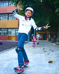 Skyline Skaters 27 (C & R Driver-Burgess) Tags: middleschool juniorhigh kids children boys girls young teen preteen ripstick inline skates skateboard pink blue shorts tights jacket tshirt concrete yard playground trees playing practice people