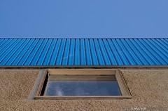 Stucco and Metal (djhsilver) Tags: thunder bay thunderbay simpson street simpsonstreet corrugated metal window stucco blue