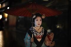 Black eyes (karinavera) Tags: night photography urban ilcea7m2 kimono japan street geisha umbrella kyoto people walking