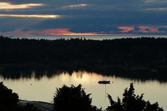 Sunset (evisdotter) Tags: sunset sky clouds colors landscape seascape nature sooc västerhamn mariehamn åland light reflections segelbåt