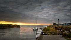 Sunrise on the lake (Unicorn.mod) Tags: 2015 colors autumn canonautumn september sunrise lake water landscape boat marina clouds sky pskov russia canoneos6d canon samyang24mmf14edasifumc samyang manual manuallens