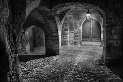 Arcades St-Martin-de-Londres (minelflojor) Tags: arcades voûte nuit éclairage vieuxvillage portes pierre ancien pavé vaulting night old village stone france hérault bâtiment arche architecture mur noiretblanc monochrome blackandwhite