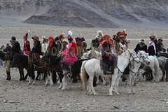30101738 (wolfgangkaehler) Tags: 2017 asia asian centralasia mongolia mongolian westernmongolia ulgii ölgii bayanulgiiprovince altaimountains altaymountains altaymts goldeneaglefestival people person kazakh competing competition competitor kyzkhuar game games youth boys girls whipped horse horseriding horserace horseback horsebackriding horsebackrider fun funny traditionalgame