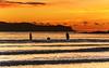 Sunrise Seascape and Silhouettes (Merrillie) Tags: daybreak uminabeach landscape nature australia mountains nswcentralcoast newsouthwales clouds nsw uminapoint beach scenery centralcoastnsw silhouettes people coastal coast sea waterscape sunrise centralcoast seascape water