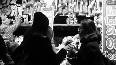 festive market at night 02 (byronv2) Tags: festive festivemarket christmasmarket peoplewatching candid street princesstreet princesstreetgardens edinburgh edimbourg edinburghbynight night nuit nacht blackandwhite blackwhite bw monochrome market mound shop shopping browsing