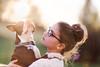 Zen Doggie (Rebecca812) Tags: girl child pet dog bostonterrier cute zen meditation eyeglasses beautiful lensflare light sunset profile sideview love bond togetherness sunlight canon people portrait candid happiness meditate sweet tween animal collar tag holding rebeccanelson rebecca812