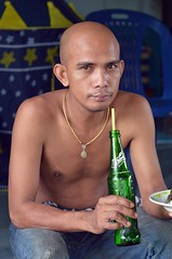 still has that 100-yard monk stare (the foreign photographer - ฝรั่งถ่) Tags: jul192015nikon young man seated soda soft drink khlong lat phrao portraits bangkhen bangkok thailand nikon d3200
