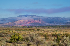 view toward red mesa (johngpt) Tags: fujinonxf55200mmf3548rlmois us550nearsanysidronm fujifilmxt1 viewtowardredmesa fence newmexico cliff places clouds ziapueblo unitedstates us ~~fencefriday~~ hff