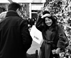 cheerful (LozHudson) Tags: manchesterchristmasmarkets manchester monochrome blackwhite people fuji fujifilmx100s x100s