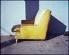 Yellow on blue on sidewalk (ADMurr) Tags: la southla sidewalk castoff chair yellow blue mamiya 7 80mm 6x6 mf kodak ektar film cab832