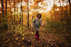 Wondering in the woods (Elizabeth Sallee Bauer) Tags: nature active autumn backyard beautyinnature boy child childhood colorful copyspace environment evening fall fun goldenlight green kid leaf leaves nonurbanscene orange outdoors outside playing preperation stick trees warmtones winterizing youth