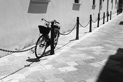 Biciclecce (Elios.k) Tags: horizontal outdoors nopeople bicycle basket street alley road stonepaved bike blackandwhite monochrome bw chained emptystreet dof depthoffield focusinforeground backgroundblur perspective travel travelling april 2017 spring vacation canon 5dmkii photography lecce puglia apulia salento italy europe