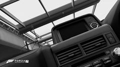 Modernisation (Mr. Pebb) Tags: blackandwhite blackwhite bw desaturated pits interior nissan skyline skylinegtrvspec r34 stockshot car asian japanese fourseater twodoor awd allwheeldrive 4wd frontengined turbocharged videogame racinggame racegame xbox xboxone ms microsoft turn10 t10 forza forzaseries forzamotorsport7 fm7 forza7 photomode screenshot screencapture