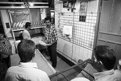 Iranian baker (damonlynch) Tags: iran iranian middleeast middleeastern people persian places shiraz adult adults baker bakery building business buy buying capitalism commerce commercialbuilding enterprise humanbeings humans male man masculine men person purchase purchasing sell selling store trade farsprovince
