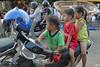 Pub street Siem Reap (Cambodia) (Guy World Citizen) Tags: kids motocycle streetscene people waiting siemreap cambodia