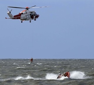 Porthcawl Lifeboat on a training exercise with Coastguard Helicopter 187