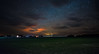 Village Under the Stars (free3yourmind) Tags: belarus village under stars sky clouds cloudy night green grass field houses dramatic