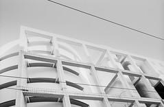 Lyon (Bourguiboeuf) Tags: lyon city building street argentique analogue pellicule film 135 35mm ishootfilm ibelieveinfilm filmisnotdead noir et blanc nb bw black white monochrome bourguiboeuf homedev ville rue onlylyon brutalist brutal architecture beton park