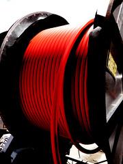 The Red Reel (Steve Taylor (Photography)) Tags: red reel cable drum label art digital black yellow plastic newzealand nz southisland canterbury christchurch cbd city broadband laying ultrafast fibreoptics