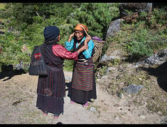 Old Tibetan women on the trail in the remote Tsum Valley near Tibet, Gorkha District, Nepal (jitenshaman) Tags: travel destinations worldlocations nepal nepali tsum tsumvalley manaslu tibet tibetan nubri trekking trek women grandmother old oldwomen oldwoman ilovetibet friends social socialise socialize meet meeting