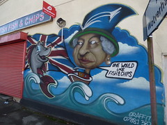 Famous British Fish & Chips - Holyhead Road, Wednesbury - graffiti street art - The Queen (ell brown) Tags: wednesbury blackcountry sandwell westmidlands england unitedkingdom greatbritain markettown holyheadrd shop famousbritishfishchips chipshop fishchips graffiti streetart thequeen elizabethii queenelizabethii onewouldlikefishchips unionjack kemefinc justeat