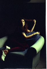 Teresa Love Seat 1 (neohypofilms) Tags: series art studio lighting gritty raw sexy velvet girl model shoes clogs wooden retro 70s 60s hair redhead 35mm film slr nikon vintage couch chair loveseat white drama color colours