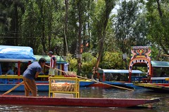 Snack salesman punting his way to new customers in Xochimilco (nickdippie) Tags: mexico xochimilco ciudaddemexico canal boat canalboat gondolier colourful streetfood canalfood