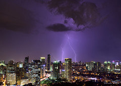 Hit the road (Sumarie Slabber) Tags: lightning weather city skyline buildings lights sky clouds storm nature manila philippines sumarieslabber