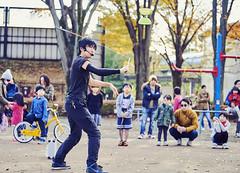 master of juggle (PHOTOGRAPHYSUAT) Tags: spin rope black openair park public master juggling juggler kids fun enjoy nikon 70200mm d4 speed fall yellow sun suny tokyo ground fly ufo