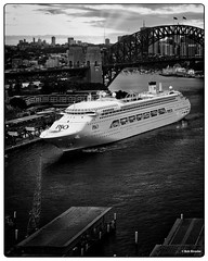 Approaching the Wharf (PEN-F_Fan) Tags: mirrorless microfourthirds monochrome olympusmzuiko12100mmf40pro monotone filmlook dxophotolab harbor mft luminar2018 olympuspenf sydneyharborbridge sky wharf water pencamera on1photoraw photoborder raw postprocessing cruiseship blackandwhite bay building clouds camera circularquay newsouthwales australia ship boat