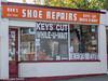 Keys Cut (M C Smith) Tags: pentax k3ii letters numbers symbols shop window door red orange white pavement shoe keys repair trees green sky blue reflections