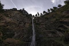 A long way down (flurryofsmoke) Tags: multnomahfalls waterfall rocks cliff trees solarhalo hdr oregon usa