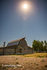 The sun shines bright above historic Moulton Barn on Mormon Row, Grand Tetons National Park, Teton County, Wyoming. (Remsberg Photos) Tags: eclipse grandteton jackson landscape mountains nationalpark solar tetons west wyoming colorimage grandtetonnationalpark beautyinnature moultonbarn thomasalmamoulton mormonrow antelopeflats jacksonhole barn worn historic nature traveldestination rualscene westernusa outdoors skyline sky traveldesintations tourism famousplace tranquilscene majestic impressive noble elevated splendid sunlight sun clearskies heavenly blissful divine sublime focus concentration tamoultonbarn rockymountains usa