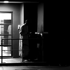 In the doorway (pascalcolin1) Tags: paris13 homme man nuit night lumière light ombres shadows africain african photoderue streetview urbanarte noiretblanc blackandwhite photopascalcolin 50mm canon50mm canon