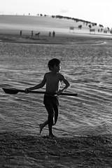 The boy of the dune - b&w (alestaleiro) Tags: boy child niño kid jeri jericoacoara monochrome bw bianconero monocromo action ocean water dune portrait candid alestaleiro