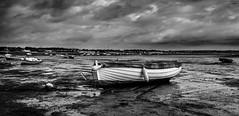Black and White muddy boat (paullangton) Tags: blackandwhite bw coast seascape clouds eastcoast river canon estuary sailing mud storm wide 7dmk2