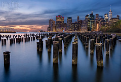 On The Waterfront (Explore #9) (mikeSF_) Tags: new york brooklyn bridge east river eastriver brooklynbridge newyork ny nyny night sunset longexposure pilings waterfront shore shoreline skyline sky skyscraper landscape pier pillar manhattan island liberty statue worldtrade center dumbo fulton landing overpass one world trade